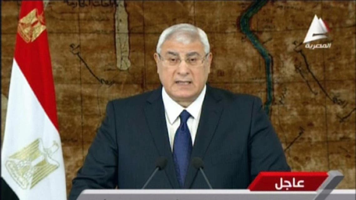 An image grab taken from Egyptian state TV on January 26, 2014, shows Egypt interim president Adly Mansour giving a speech in Cairo. AFP