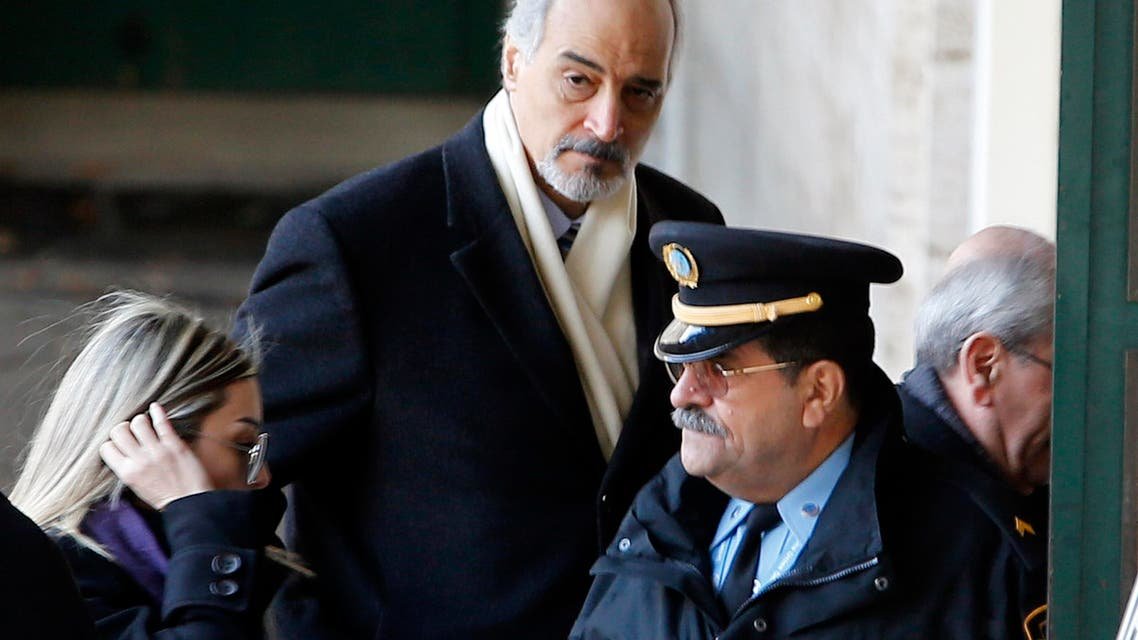 Luna Chebel (L) and Bashar al Jaafari (C), part of a Syrian government delegation, arrive for a meeting with U.N.-Arab League envoy for Syria Lakhdar Brahimi (not seen) at a U.N. office in Geneva January 24, 2014.