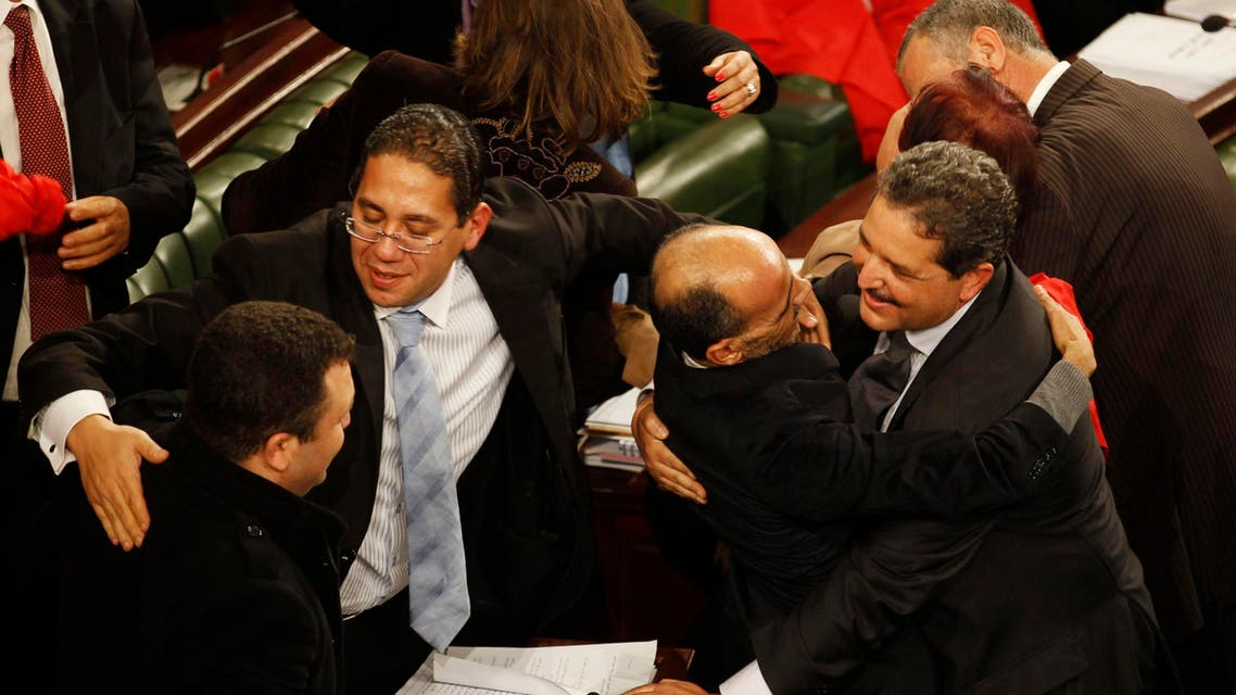 Members of the Tunisian parliament celebrate after approving the country's new constitution in the assembly building in Tunis January 26, 2014. (Reuters)