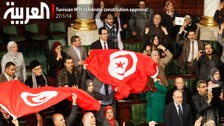 Tunisian MPs celebrate constitution approval