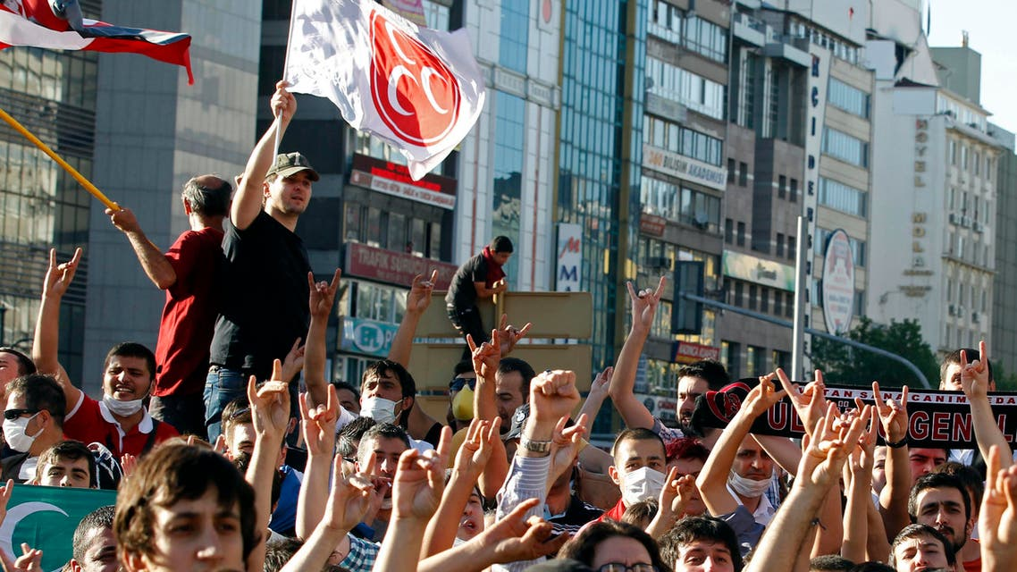 Supporters of the Nationalist Movement Party make the grey wolf sign of the party and shout slogans as one waves a party flag during a protest against Turkey's Prime Minister Tayyip Erdogan. (File photo: Reuters)