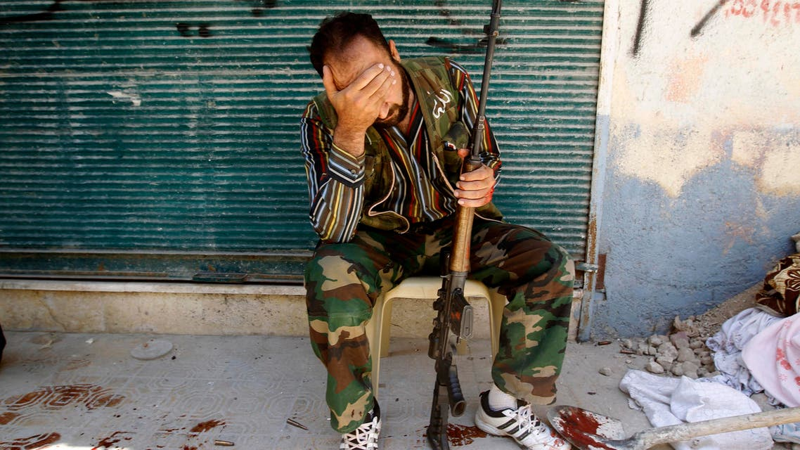 A Free Syrian Army fighter reacts after his friend was shot by Syrian Army soldiers during clashes in the Salah al-Din neighbourhood in central Aleppo in this August 4, 2012 file photo. reuters