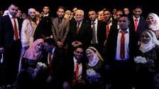 Palestinian leader presides over mass wedding