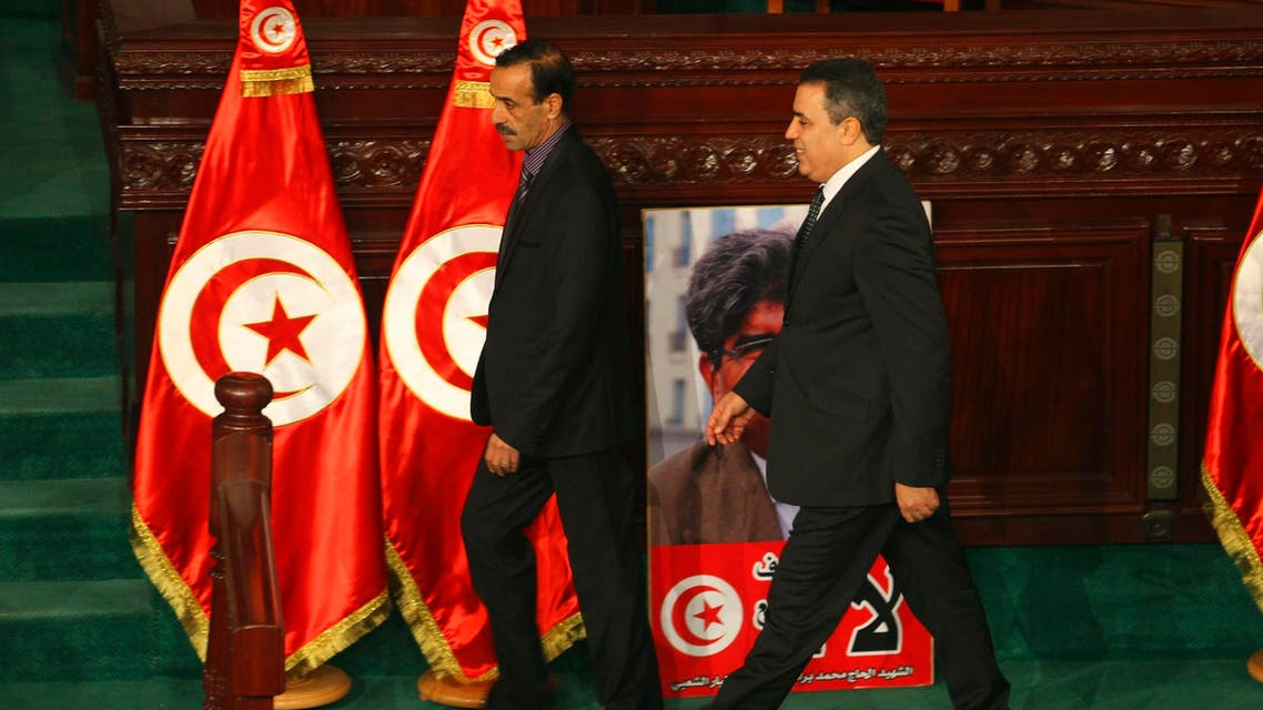 Tunisia's Prime Minister Mehdi Jomaa (C) arrives to deliver a speech in the constituent assembly and present his government in Tunis January 28, 2014.