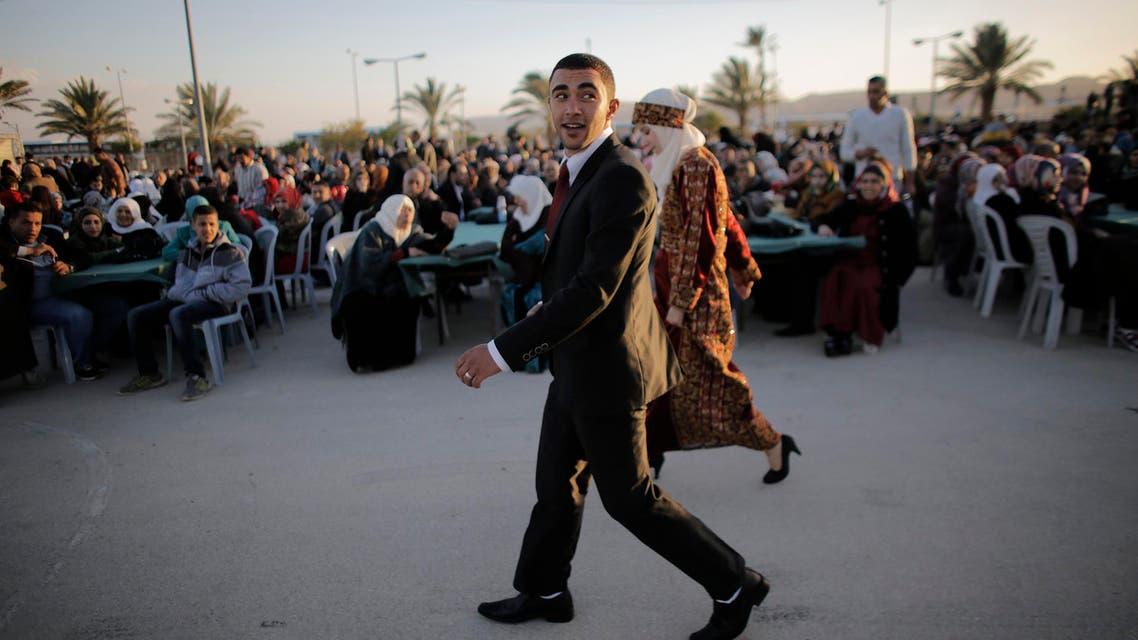 Palestinians attend mass wedding ceremony