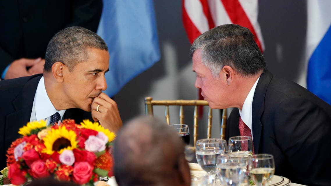 U.S. President Barack Obama talks with Jordan's King Abdullah (R) during a luncheon at the United Nations General Assembly in New York September 24, 2013.
