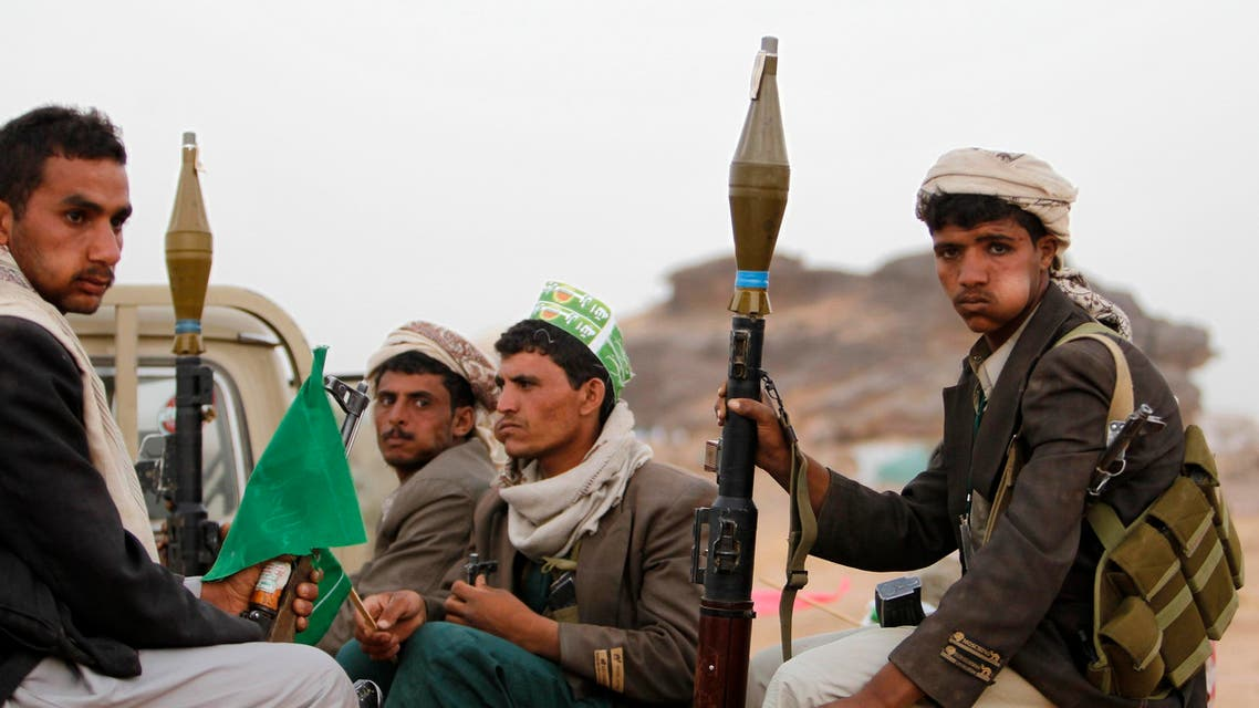 Armed followers of Yemen's Shi'ite Houthi group sit on a truck patrolling the vicinity of a ceremony attended by fellow Shi'ites in Dhahian of the northwestern Yemeni province of Saada Feb. 3, 2012. (Reuters)
