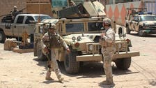 Explosions, clashes kill 18 soldiers in Iraq