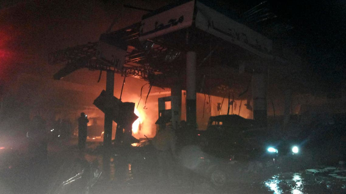 A damaged petrol station is seen at the site of an explosion in the Shi'ite town of Hermel February 1, 2014. (Reuters)