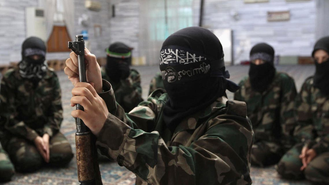 A female member of anther jihadist battalion, the Ahbab Al-Mustafa Battalion, assembles a rifle during military training in a mosque in the Seif El Dawla neighborhood in Aleppo. (File photo: Reuters)