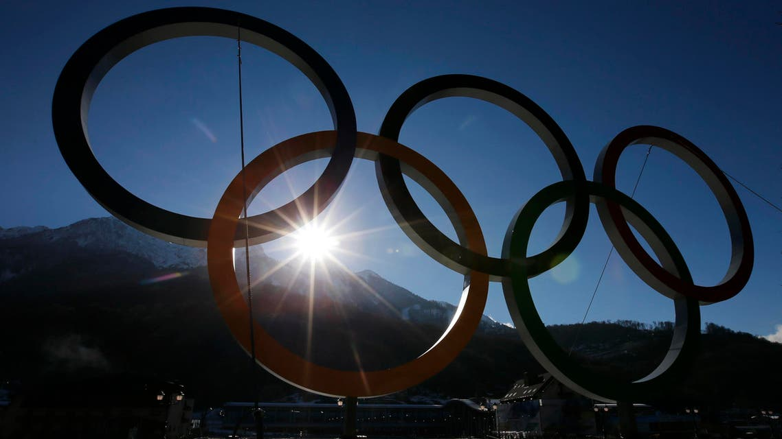 The Olympic rings are pictured in front of mountains at the Rosa Khutor Alpine Resort in Krasnaya Polyana near Sochi, February 2, 2014. Sochi will host the 2014 Winter Olympic Games from February 7 to 23.