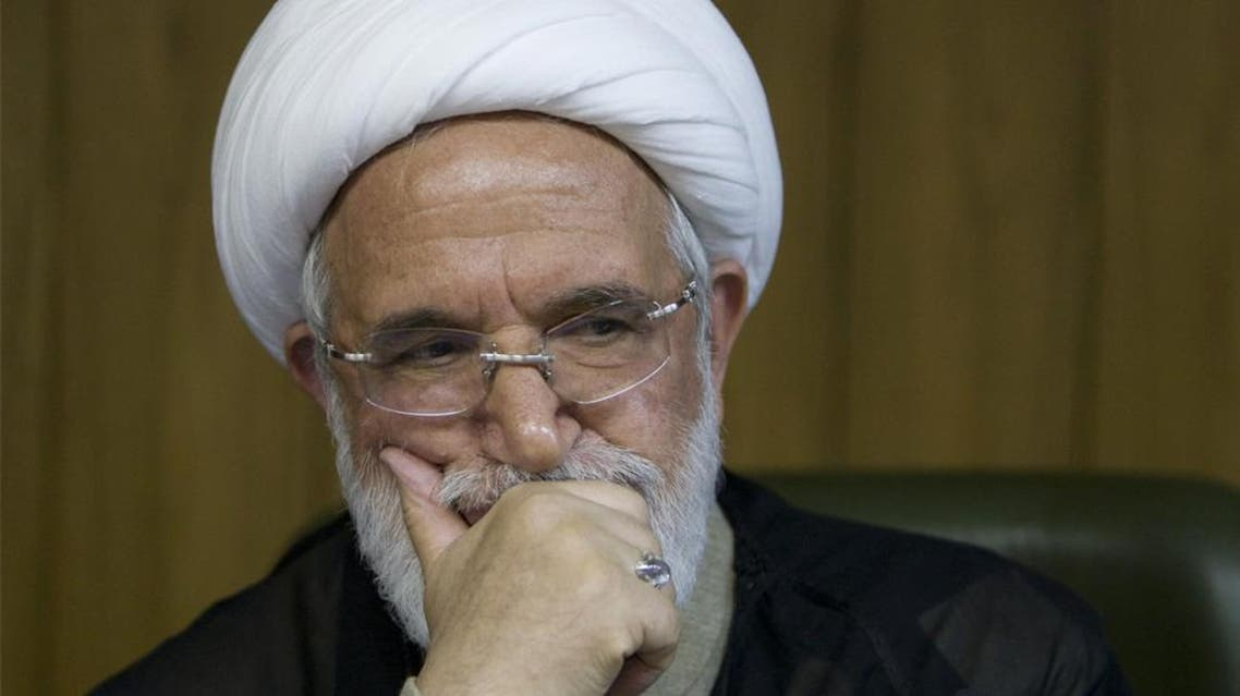 Iranian authorities have eased restrictions on detained opposition cleric Mehdi Karroubi, who helped lead big anti-government protests in 2009 (ReuteS)