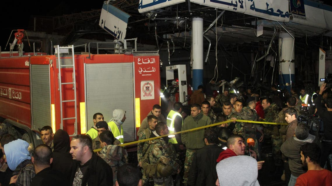 Lebanese emergency personnel are seen at the site of a car bomb explosion targeting a petrol station in eastern Lebanon's town of Hermel on February 1, 2014