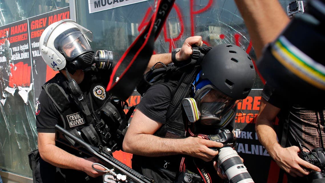 A Turkish riot policeman pushes a photographer during a protest at Taksim Square in Istanbul June 11, 2013. (File photo: Reuters)