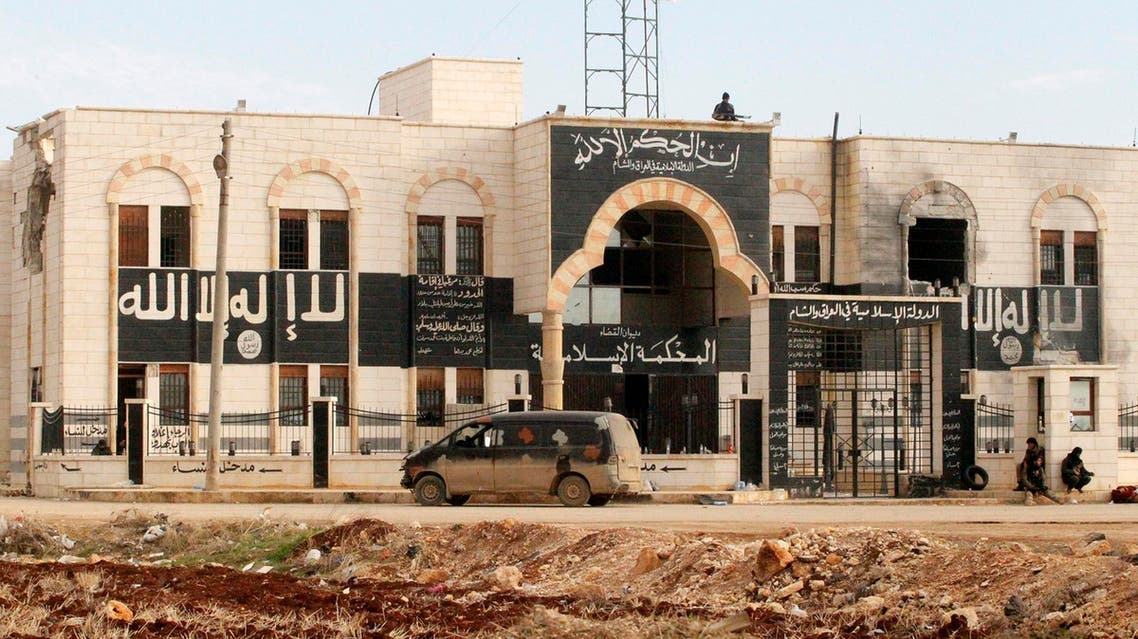 Rebel fighters stand guard at a former base used by fighters from the Islamic State in Iraq and the Levant (ISIL), after they captured it from the ISIS in al-Dana town in Idlib province Jan. 9, 2014. (Reuters)