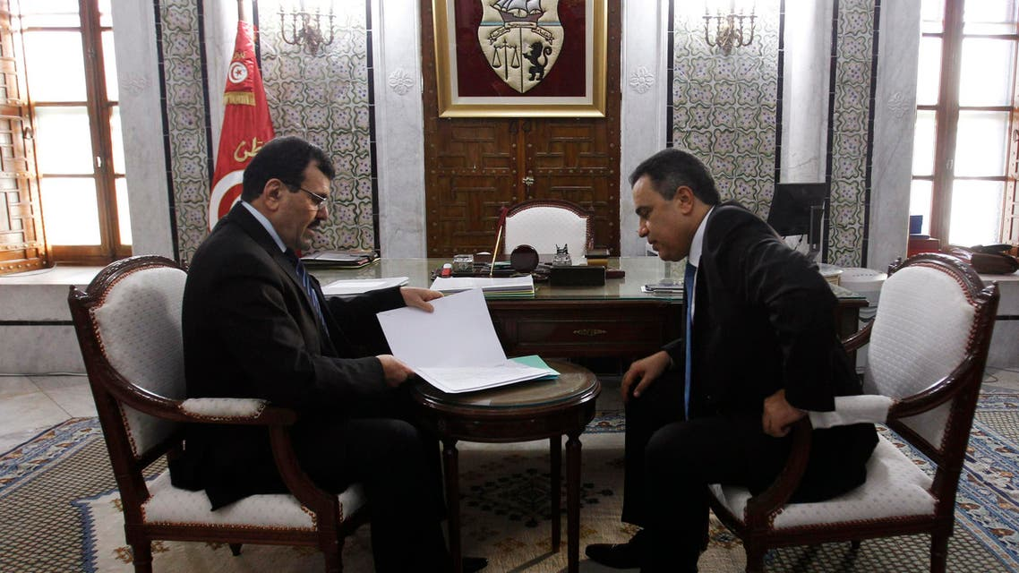 Tunisia's Prime Minister Mehdi Jomaa (R) meets with former Prime Minister Ali Larayedh during a handover ceremony at the government palace in Tunis January 29, 2014. reu