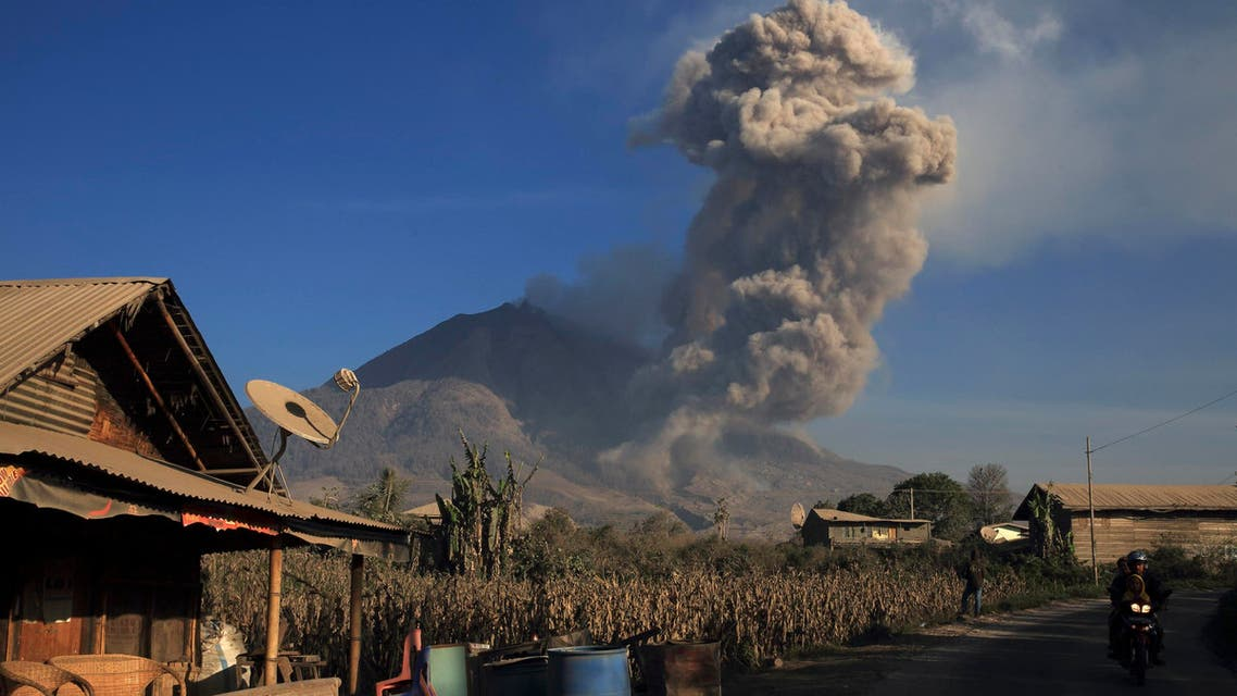 Mount Sinabung spews ash at a village in Indonesia
