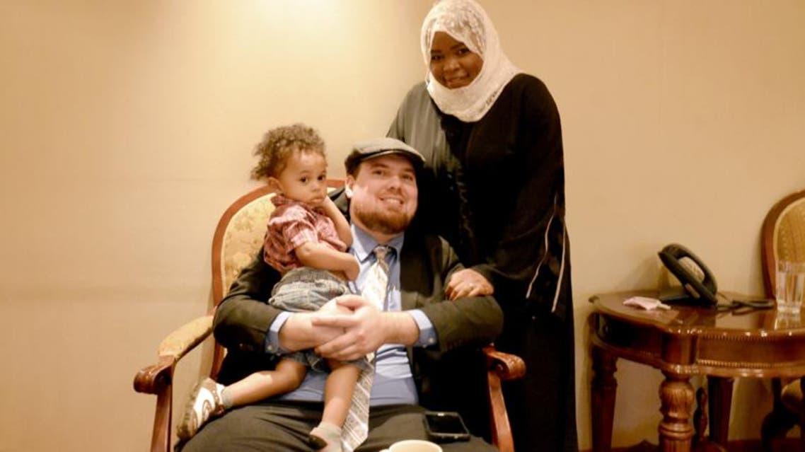 Saudi pilot Nawal al-Husawi, her husband David McCarthy and their child pose for a picture after an interview in Riyadh. (Al Arabiya)