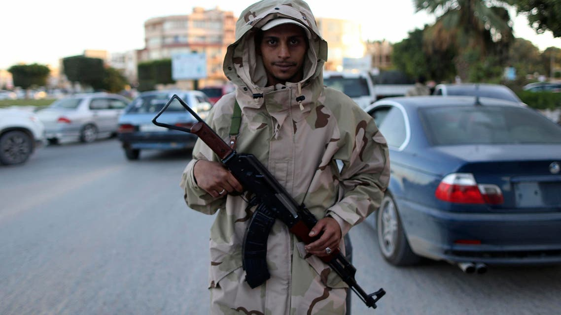A member of the Libyan army stands guard along a street following a clash in Benghazi Nov.26, 2013. (File Photo: Reuters)