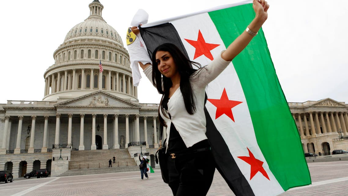 An anti-Assad protester carries the Syrian freedom flag in front of the U.S. Capitol in Washington Reuters