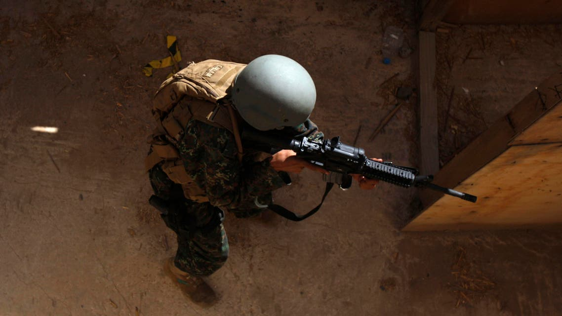 A member of Yemen's U.S.-trained counter-terrorism force takes part in a house raid training near Sanaa reu