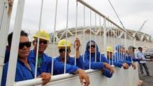 Workers threaten strike at World Cup stadium