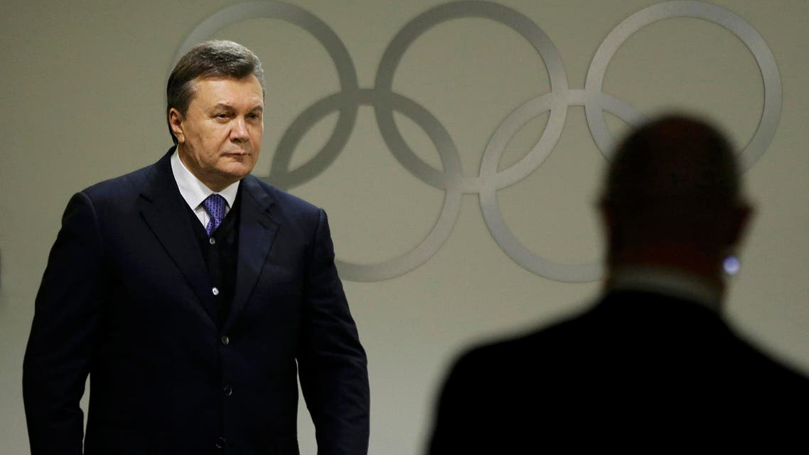 Ukrainian President Viktor Yanukovych walks through the presidential lounge to take his seat at the opening ceremony of the 2014 Winter Olympics in Sochi, Feb. 7, 2014. (Reuters)