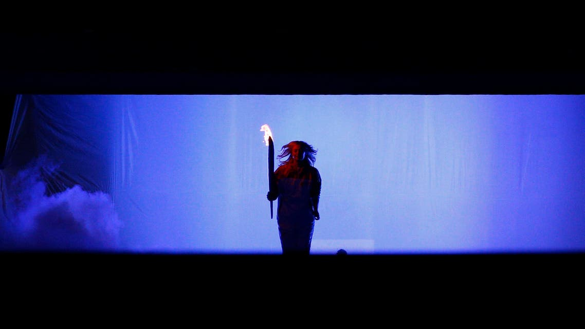 Russian tennis player Maria Sharapova holds the Olympic Torch during the opening ceremony of the 2014 Sochi Winter