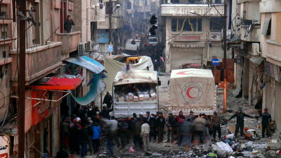 Syrian Arab Red Crescent trucks stand in the besieged neighbourhoods of Homs to supply humanitarian aid February 8, 2014. reuters
