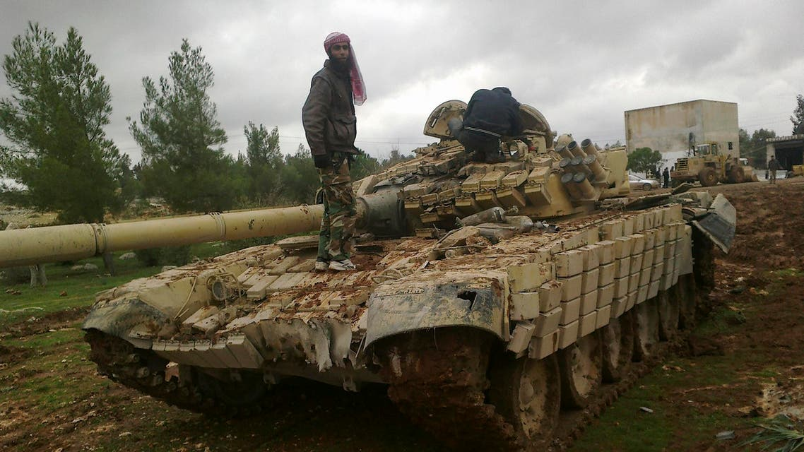 Free Syrian Army fighters inspect a tank after the fighters said they fought and defeated government troops in Al-Latameneh, near Hama December 22, 2012.