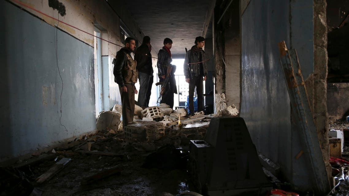 FSA fighters inspect damage from suicide bombers belonging to the ISIS in Aleppo January 12, 2014. (Reuters)