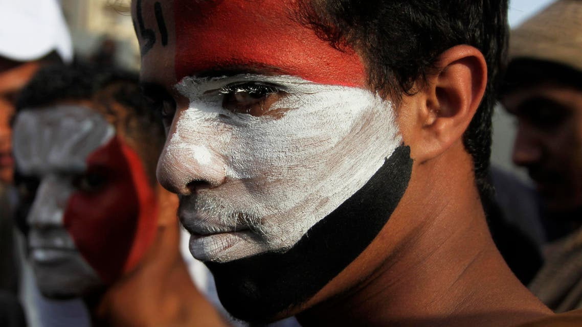 Pro-democracy protesters, with their faces painted in the colours of Yemen's national flag, look on during a demonstration to mark the anniversary of an uprising against former president Ali Abdullah Saleh in Sanaa February 8, 2014. reuters