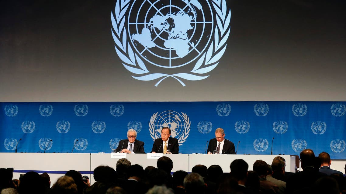 U.N. Secretary-General Ban Ki-moon (C) sits beside U.N.-Arab League envoy for Syria Lakhdar Brahimi (L) as he addresses a news conference after the Geneva-2 peace talks in Montreux January 22, 2014