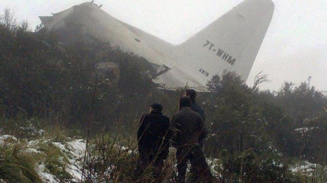A picture taken with a mobile phone shows the wreckage of an C-130 Hercules aircraft after it crashed into Mount Fertas in the Oum El Bouaghi region, about 500 km from the Algerian capital Algiers, on Feb.  11, 2014. (AFP)