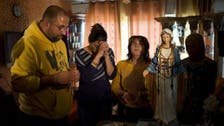 Virgin Mary 'weeping oil' attracts thousands to Israeli town