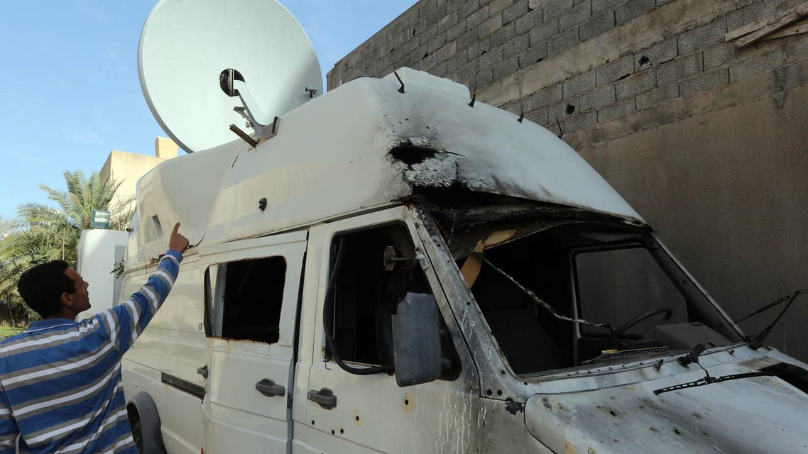 A damaged satellite van belonging to the Libyan Alasseman television station after its premises were attacked overnight with rocket-propelled grenades. (AFP)