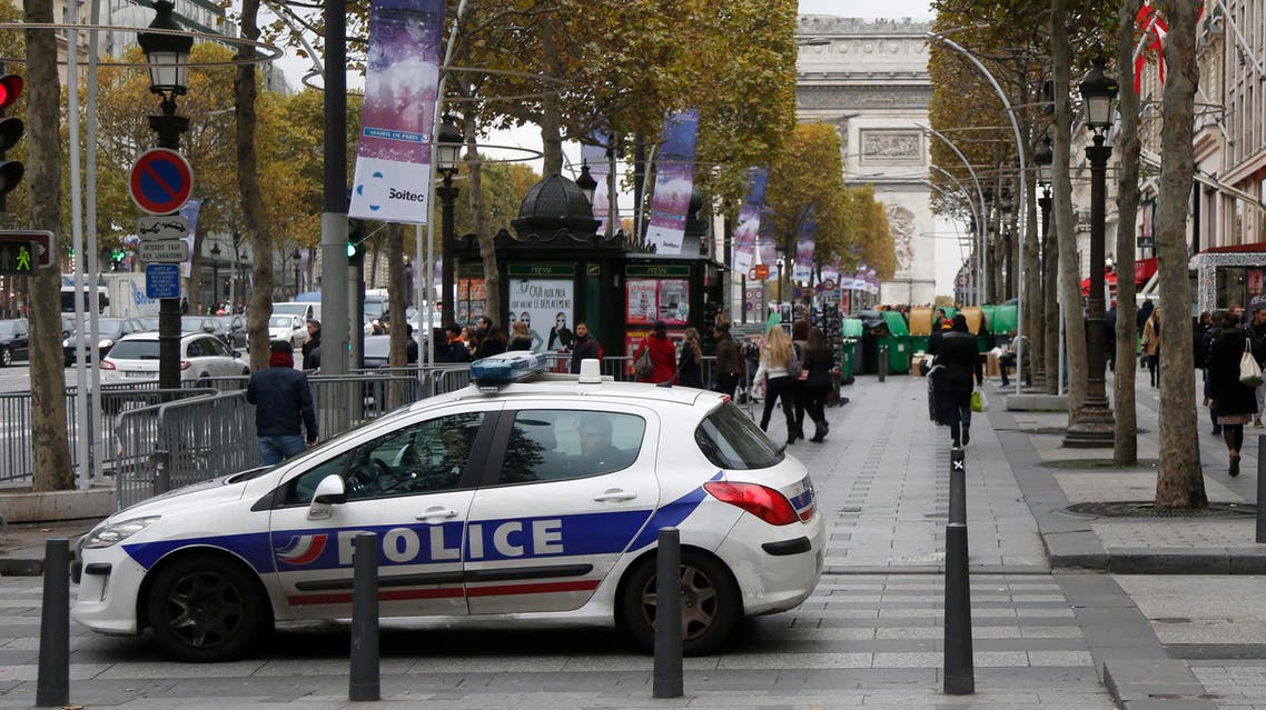 A police car patrols on the Champs-Elysees Avenue during a search operation over Paris, Nov. 18, 2013. (Reuters)