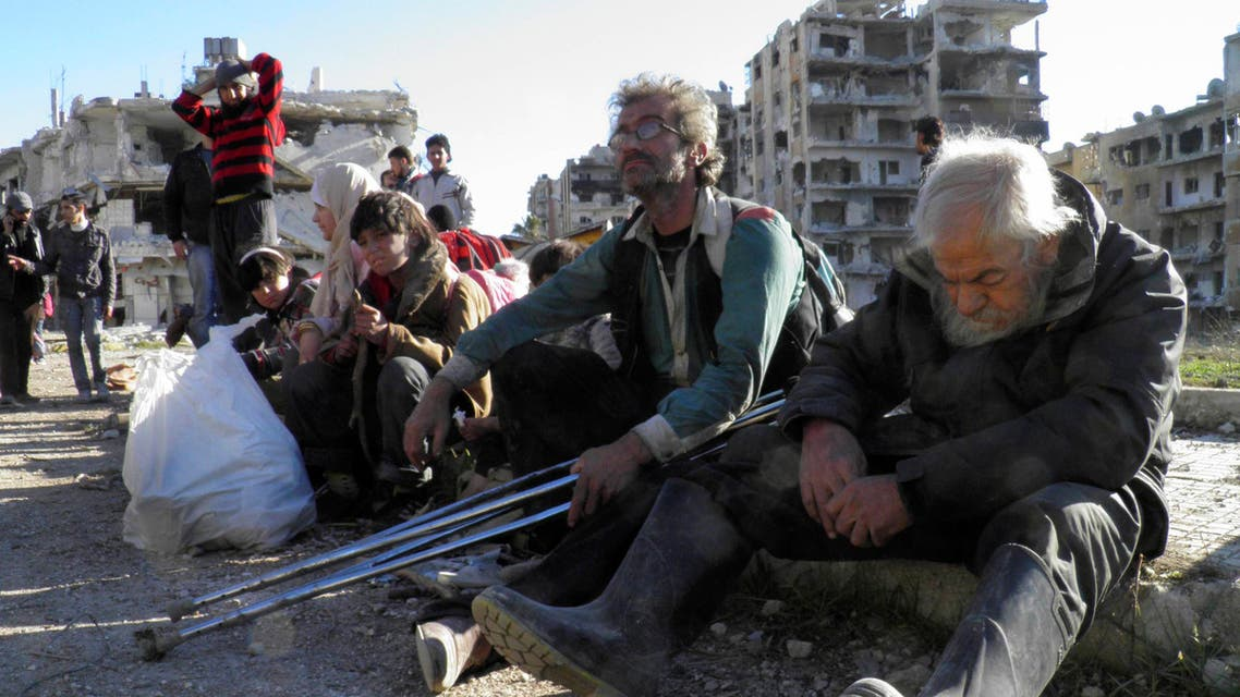 Civilians evacuate from a besieged area of Homs