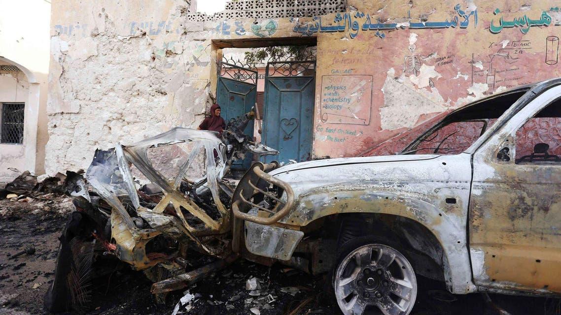 A woman looks at the scene of a car bomb attack near the Oriental Hotel in Somalia's capital Mogadishu, Feb. 10, 2014.  (Reuters)