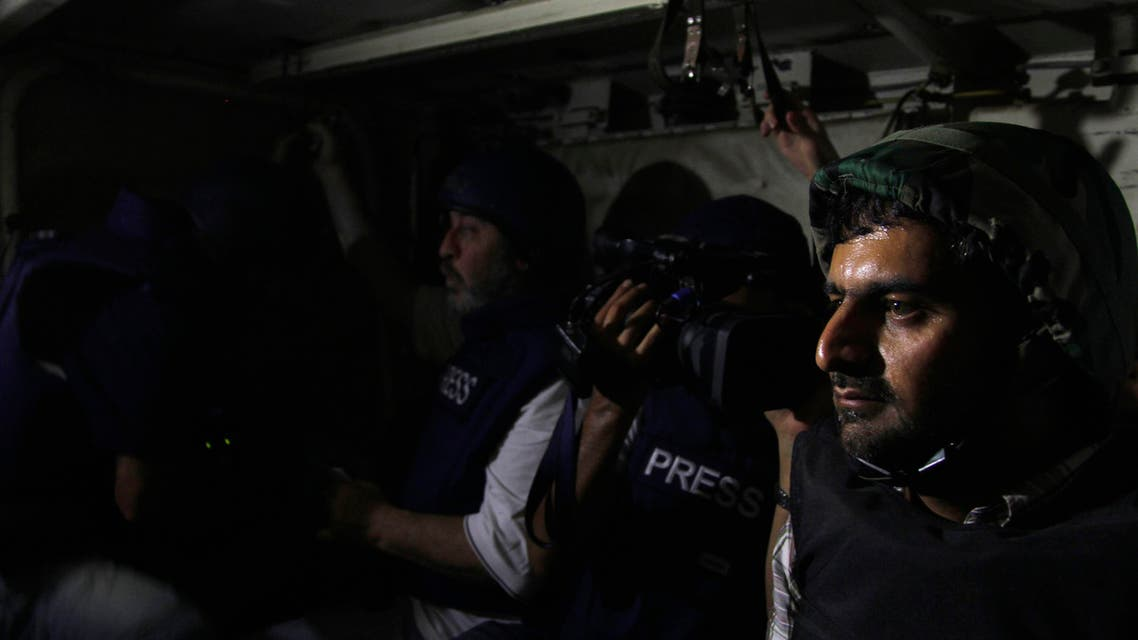 Journalists sit in an army soldier's carrier on their way to the front line, during a guided tour by the Syrian Army in the Damascus suburb of Jobar, on August 24, 2013. (File photo: Reuters)