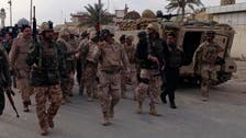 Iraq forces battle to retake town from militants