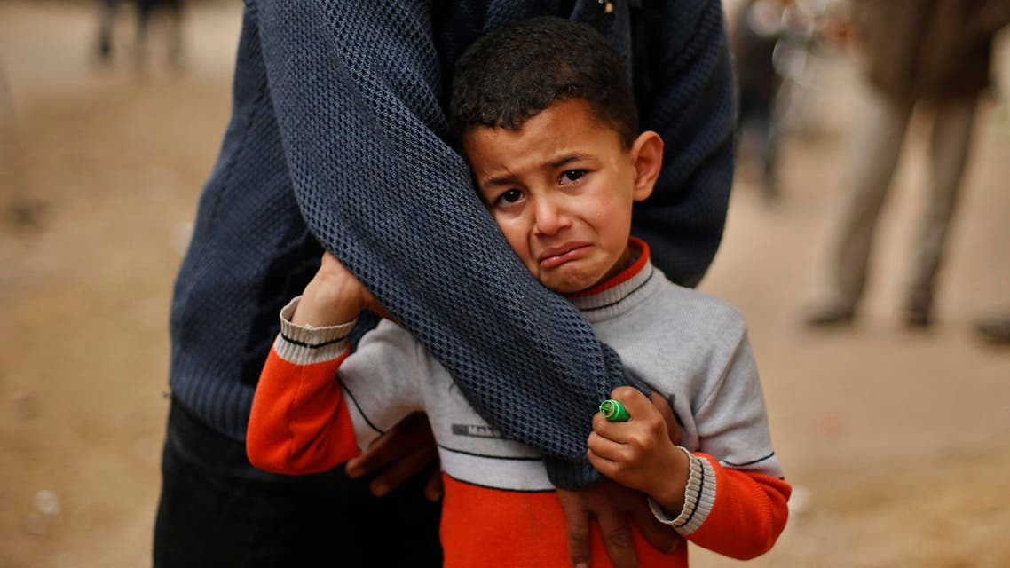 A Palestinians boy reacts during the funeral of Ibrahim Mansour, 26, who was killed by Israeli soldiers, in Gaza City February 14, 2014. Reuters