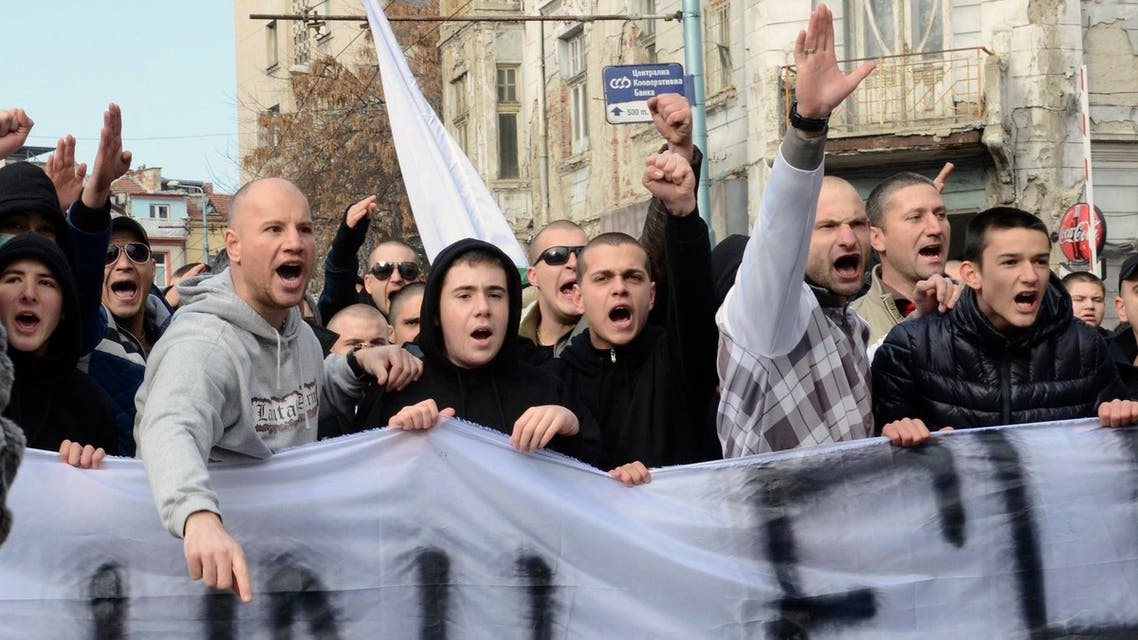 Bulgarian nationalist supporters and football fans shout slogans during a protest rally in the city of Plovdiv, some 120 km (75 miles) east of Sofia Feb. 14, 2014. (Reuters)