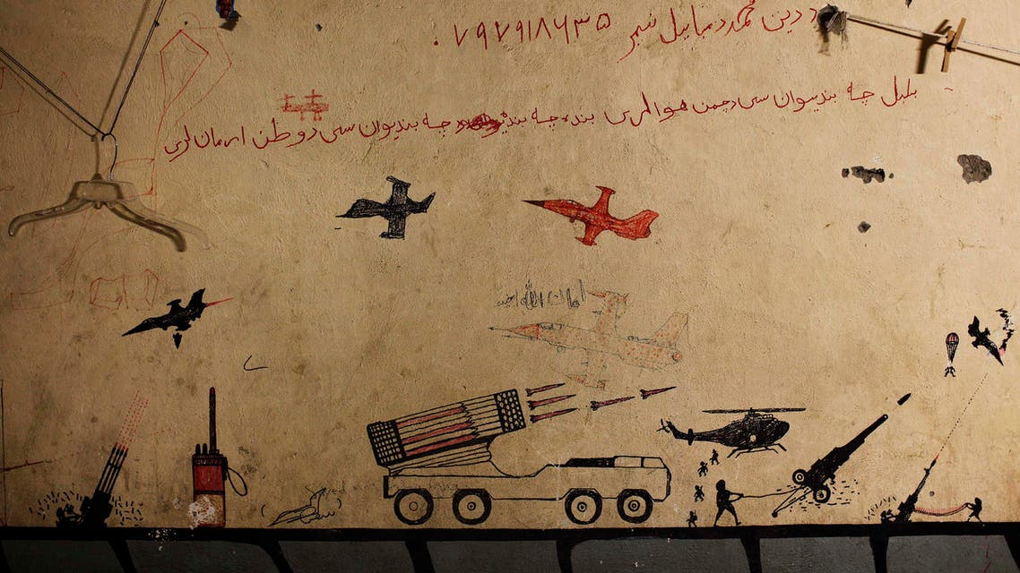 Graffiti left behind by Taliban fighters remains on the walls of a compound now used as a command center for the U.S Marine Corps's First Battalion reut