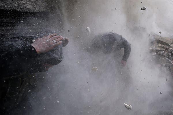 اللقطة الفائزة بجائزة الصورة الاخبارية ضمن مجموعة من 12 صورة من سوريا