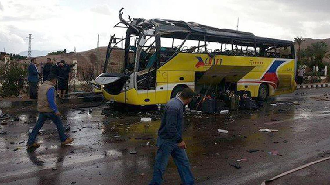 the wreckage of a tourist bus at the site of a bomb explosion in the Egyptian south Sinai resort town of Taba.