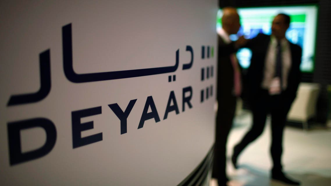 Visitors walk past a Deyaar stand during the Cityscape real estate exhibition in Dubai, Oct. 2, 2012. (File photo: Reuters)