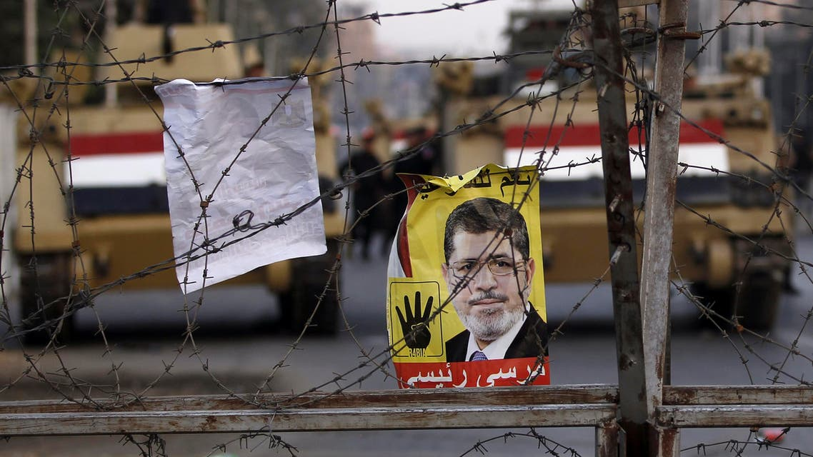 A poster of ousted Egyptian President Mohamed Mursi is pictured on barbed wires during a protest Reuters