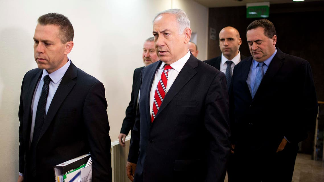 Israel's Prime Minister Benjamin Netanyahu (C) arrives to chair the weekly cabinet meeting on Feb. 16, 2014 in Jerusalem.  (AFP)