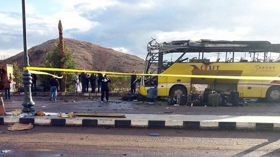A picture taken on February 16, 2014, shows the wreckage of a tourist bus at the site of a bomb explosion in the Egyptian south Sinai resort town of Taba.